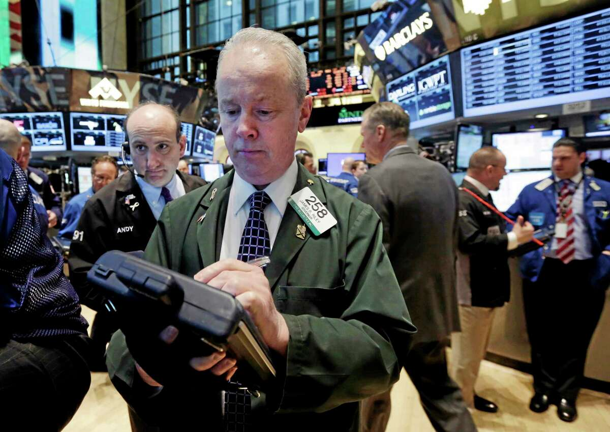 Trader James Riley, center, works on the floor of the New York Stock Exchange Tuesday.