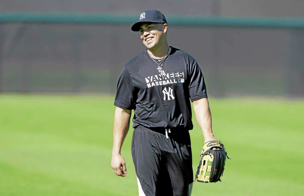 Yankees outfielder Carlos Beltran walks in the outfield during practice Monday in Tampa, Fla.