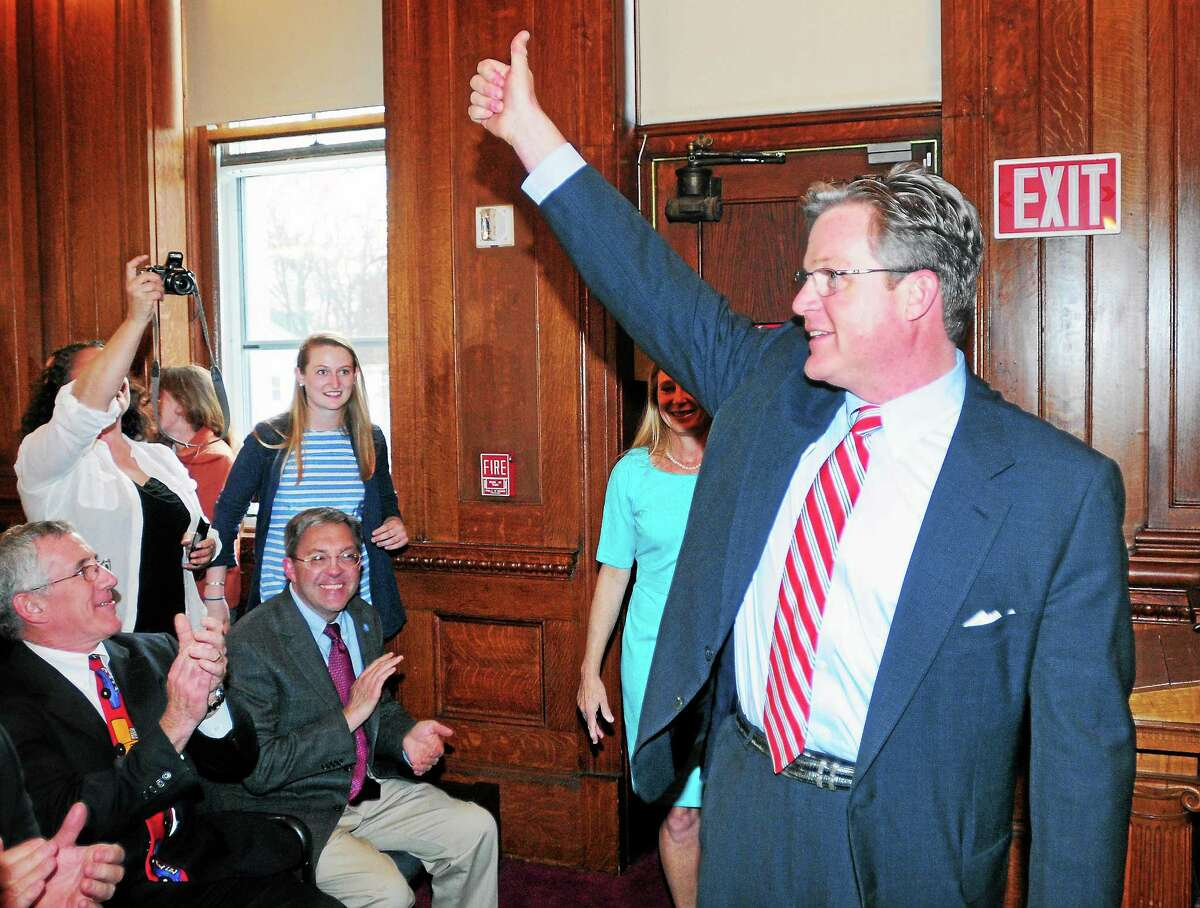 Ted Kennedy Jr. gives a thumbs-up to the crowd as he arrives at the Blackstone Memorial Library in Branford to announce his state Senate candidacy Tuesday.