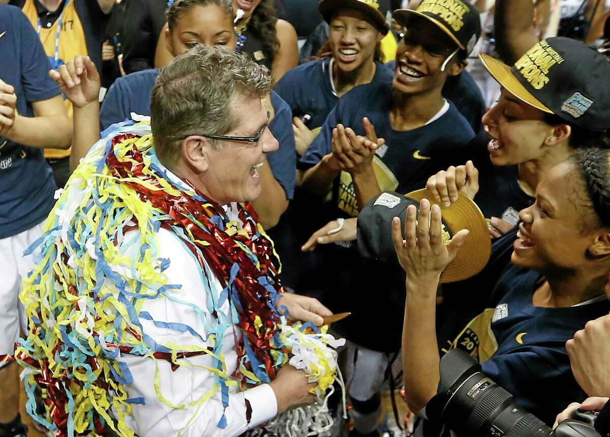 Connecticut head coach Geno Auriemma speaks to players after the second half of the championship game against Notre Dame in the Final Four of the NCAA women's college basketball tournament, Tuesday, April 8, 2014, in Nashville, Tenn. Connecticut won 79-58. (AP Photo/John Bazemore)