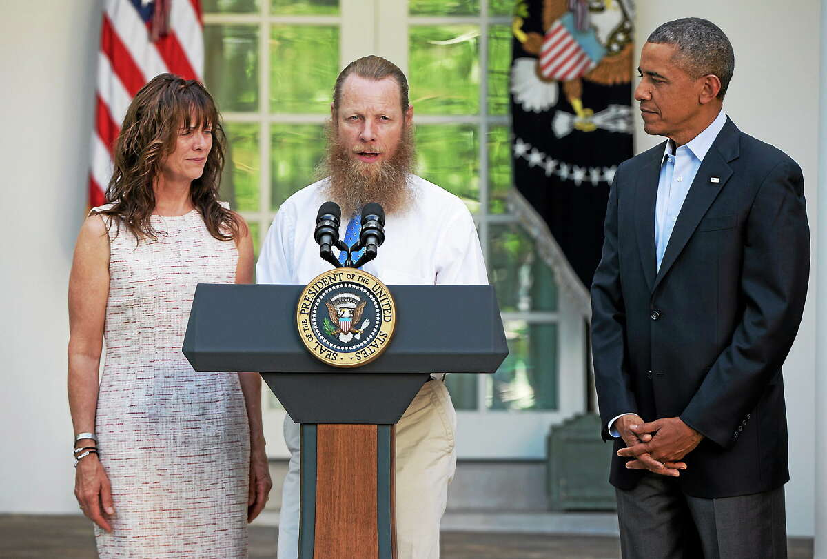 President Barack Obama looks to Jani Bergdahl and Bob Bergdahl, the parents of U.S. Army Sgt. Bowe Bergdahl, in the Rose Garden of the White House in Washington on May 31, 2014, as Bob Bergdahl speaks about the release of their son.