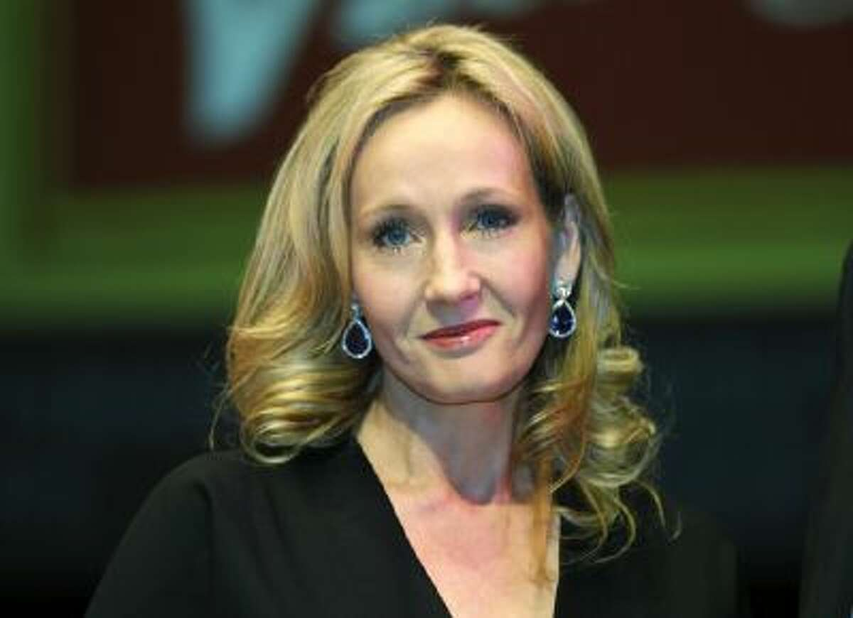 In this file photo dated Sept. 27, 2012, British author J.K. Rowling poses for photographers at the Southbank Centre in London. Rowling is back with a novel involving a writer whose acid-tipped pen may have led to murder.