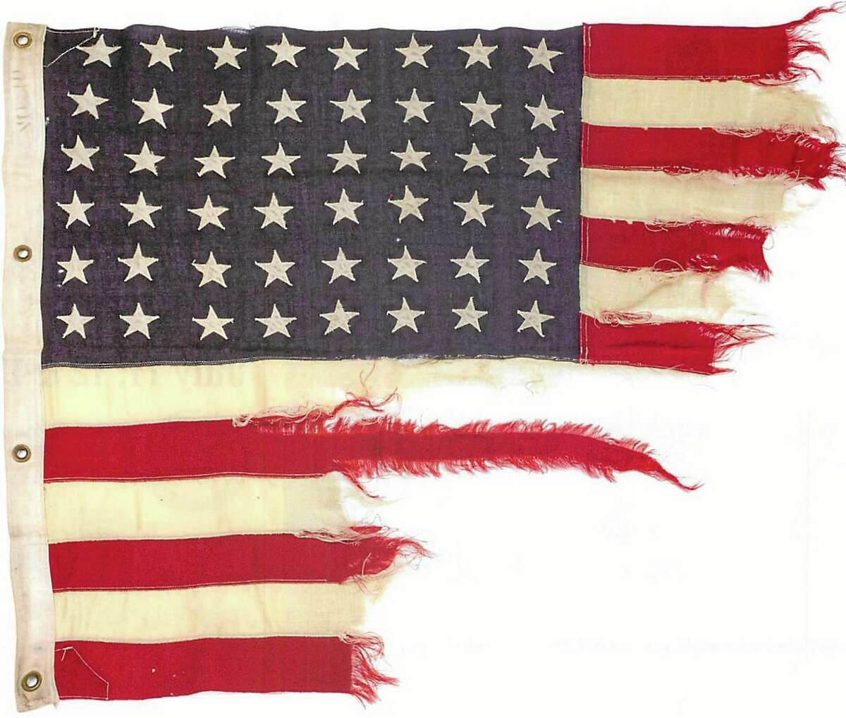 This photo provided by collector Rodney Hilton Brown shows a tattered 48-star American flag that flew aboard the U.S.-built LST 493 on D-Day that is being auctioned by Bonhams in New York on Thursday, June 5, 2014. The flag is among the hundreds of D-Day and other World War II artifacts being auctioned a day before the 70th anniversary of the history-changing invasion. The auction also features rare print-outs of the original series of hourly Dow Jones news bulletins with some of the first reports of the fighting on Franceís north coast on June 6, 1944. (AP Photo/Courtesy of Rodney Hilton Brown)