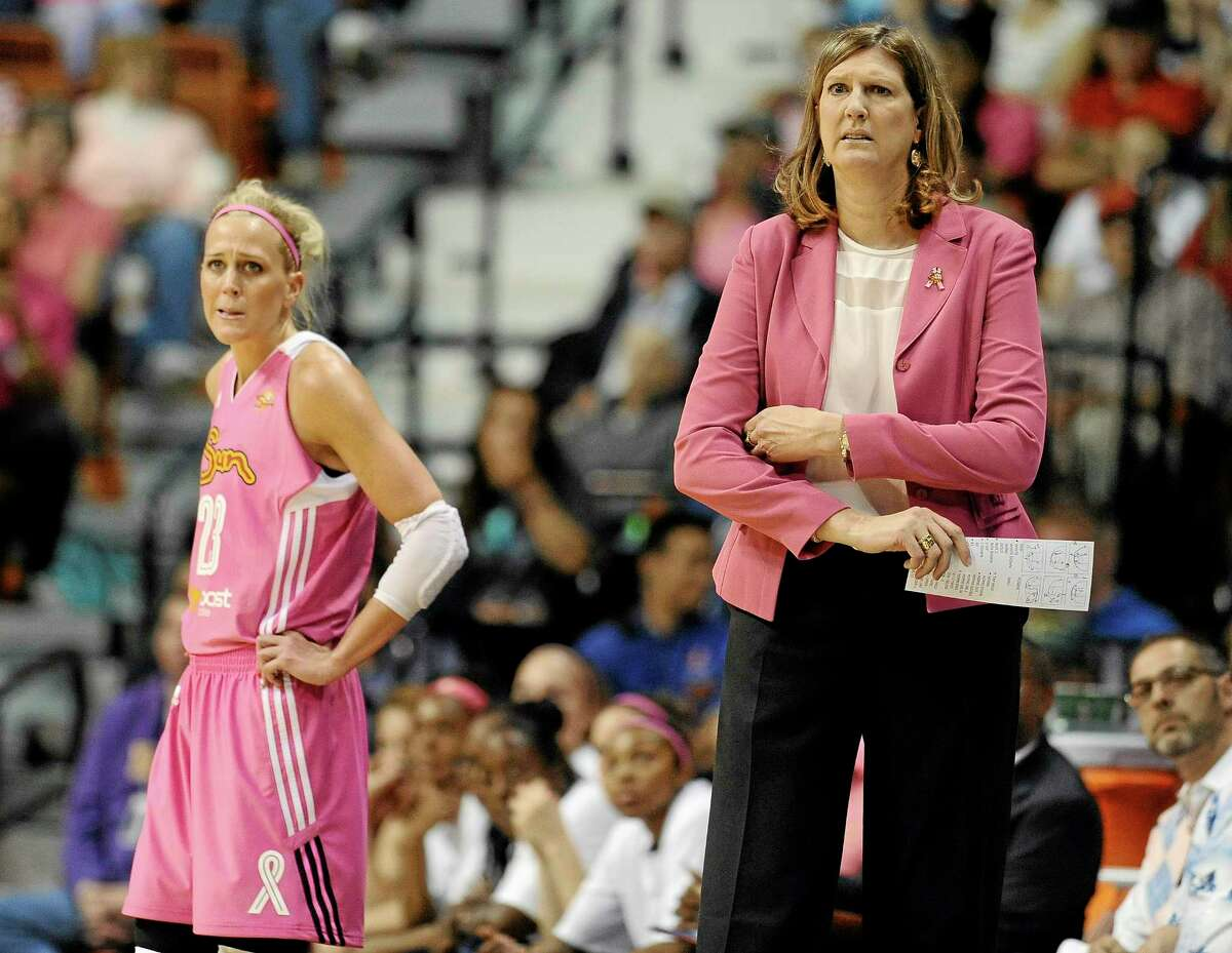 Connecticut Sun head coach Ann Donovan, right, and Katie Douglas watch play during a game earlier this season.