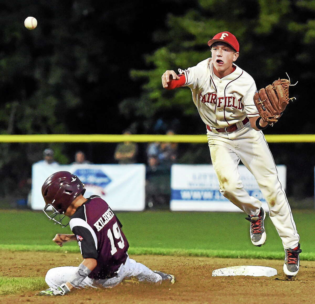 Brian Howell of Fairfield American forces out Liam Kilbreth of Goffstown (New Hampshire) at second base during the second inning Sunday.