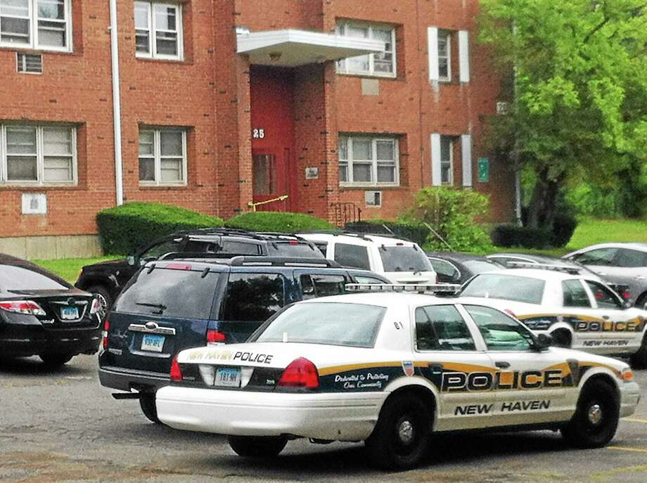 New Haven police investigate a shooting at 25 Donna Drive on August 3, 2014. Photo: Keldy Ortiz — New Haven Register