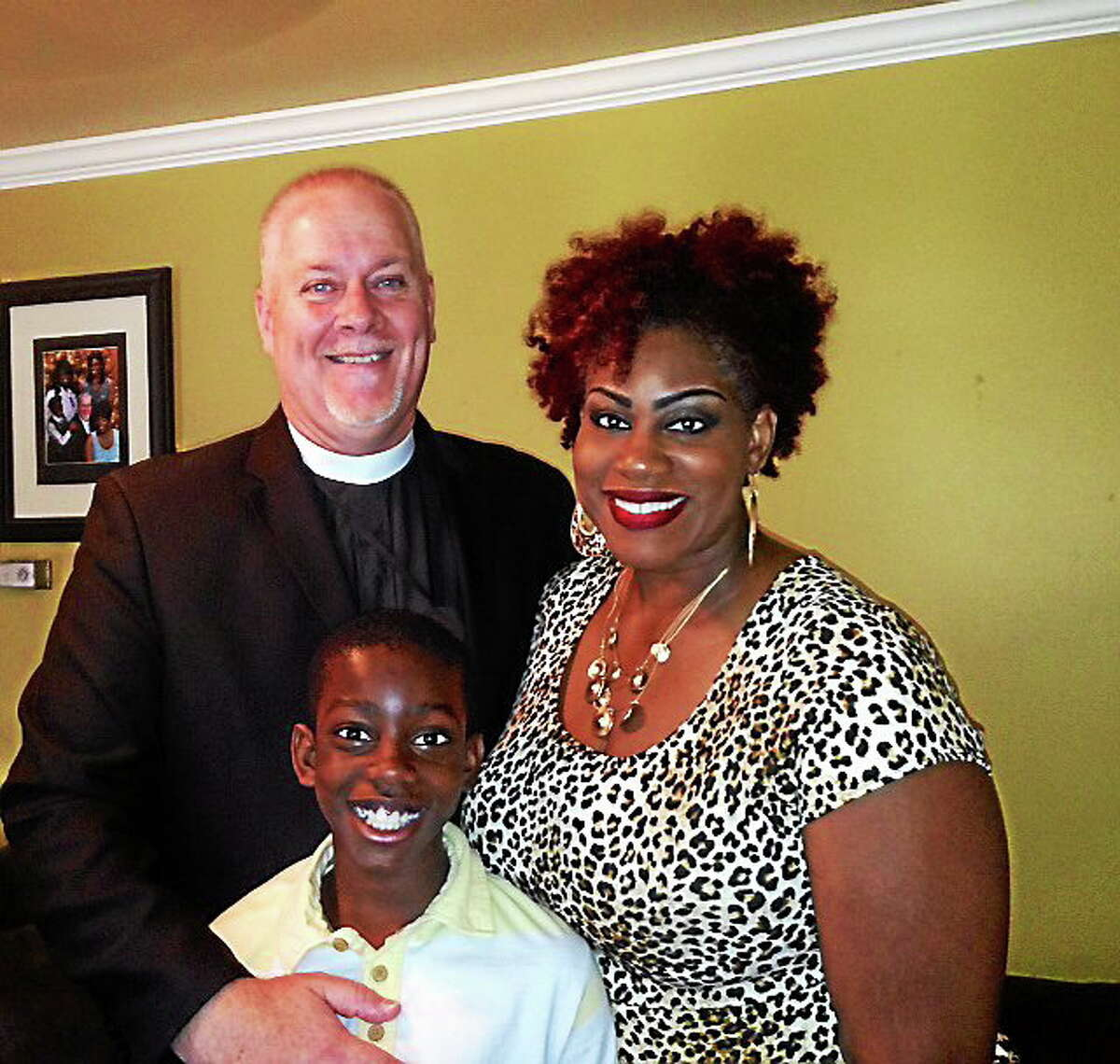 Pastor Troy McNulty stands with his wife Carlene McNulty and stepson Caleb.