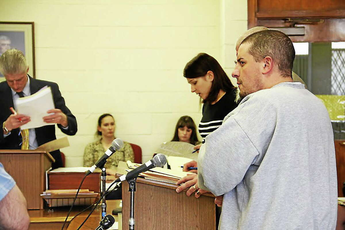 Adam Perrelli, in gray sweatshirt, appears in Superior Court in Bantam on Monday, April 7. Perrelli, of Great Barrington, Mass., is accused of making fake emergency radio calls on Litchfield County Dispatch.