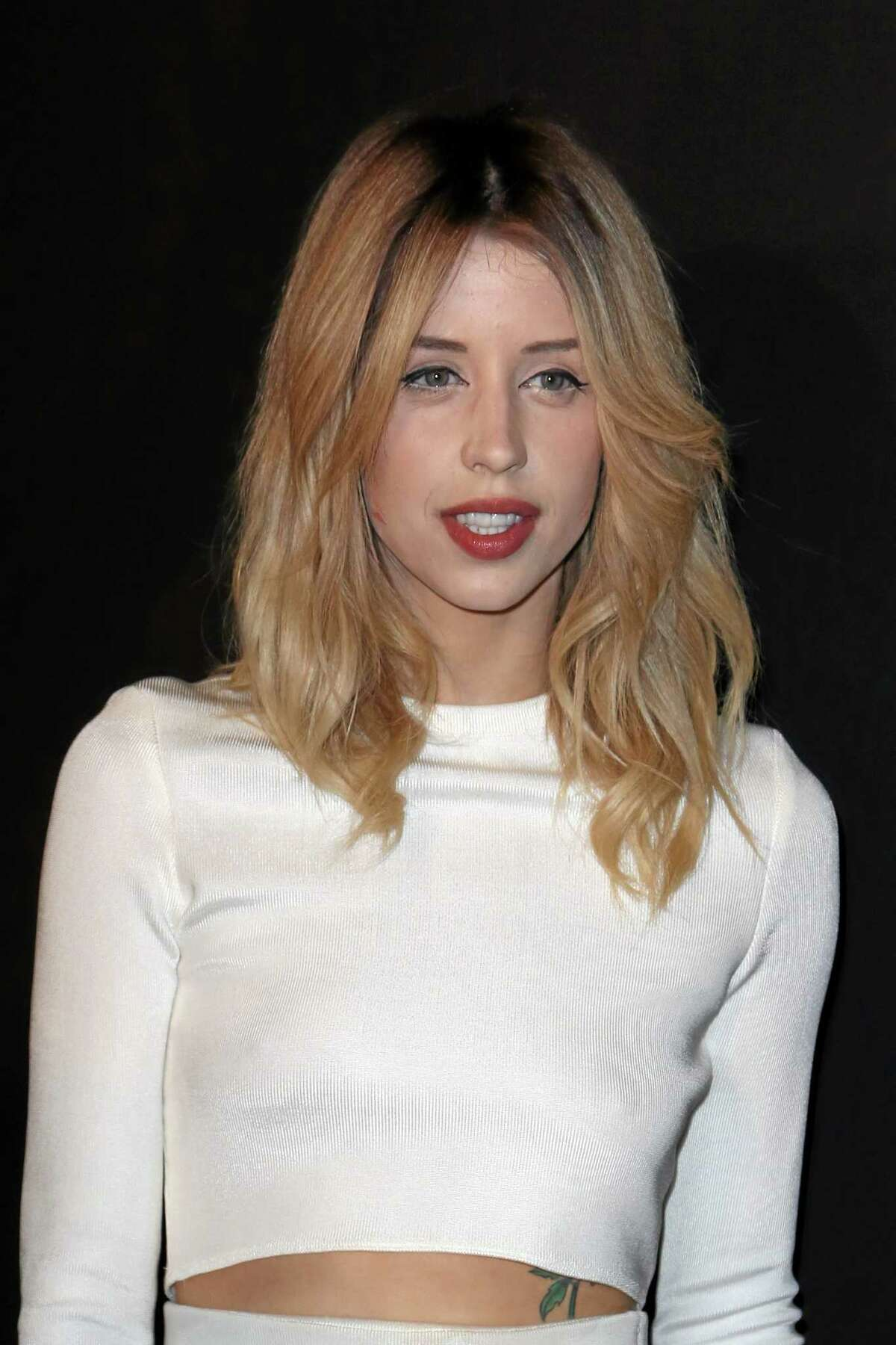 Peaches Geldof arrives to attend the ETAM's ready to wear fall/winter 2014-2015 fashion collection presented in Paris in February 2014. Entertainer Bob Geldof's agent says his 25-year-old daughter Peaches has died.