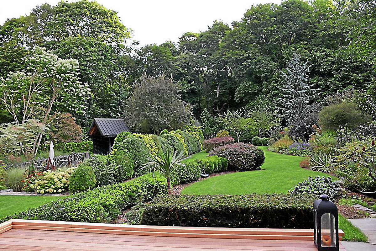 The chairman of the Brooklyn Botanic Garden is hosting a Saturday viewing of his own private garden, located at his Branford residence. Frederick Bland's garden features more than 1,400 species of plants (mostly perennials, shrubs, and small trees) arranged in many gardens: a long double border, three woodland gardens, a pool garden hidden by a serpentine tapestry hedge, and many other hedges and rock walls (all quarried on site). (contributed)