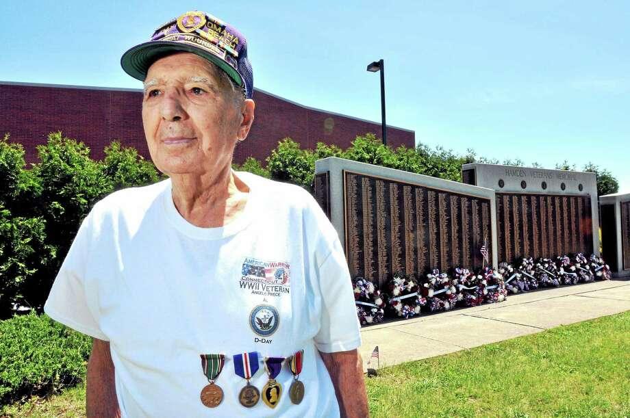 World War II veteran Al Prece, 90, of Hamden is photographed at the Hamden Veterans Memorial on May 29, 2014. Photo: (Arnold Gold — New Haven Register)