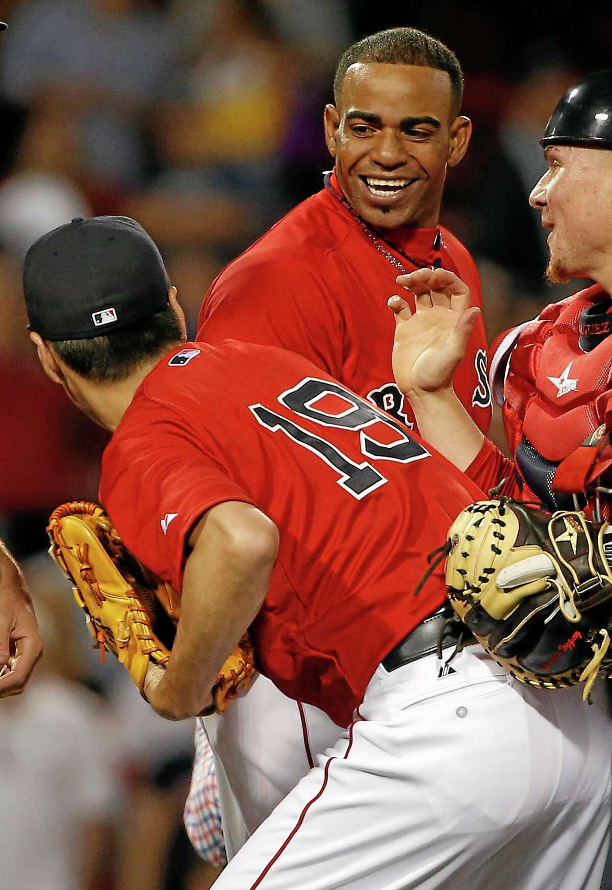 Winslow Townson - Assocated Press Boston Red Sox's Yoenis Cespedes smiles at relief pitcher Koji Uehara, of Japan, after the Red Sox defeated the New York Yankees 4-3 at Fenway Park.