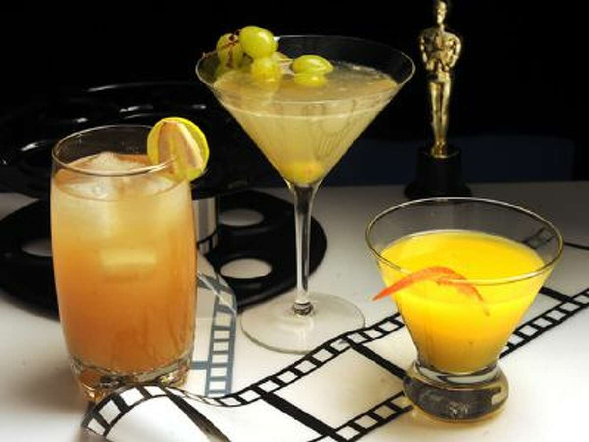 """From left, Out of This World, a tequila, lime, ginger and chipotle cocktail inspired by """"Gravity"""" and its director, Alfonso Cuaron; It's Never Enough, a gin, St. Germaine and Champagne cocktail inspired by """"The Wolf of Wall Street,"""" and The Wallbanger's Hustle, a nod to """"American Hustle,"""" a riff on the 1970s era Harvey Wallbanger, made with absinthe, vodka, Becherovka, Licor 43 and orange juice."""