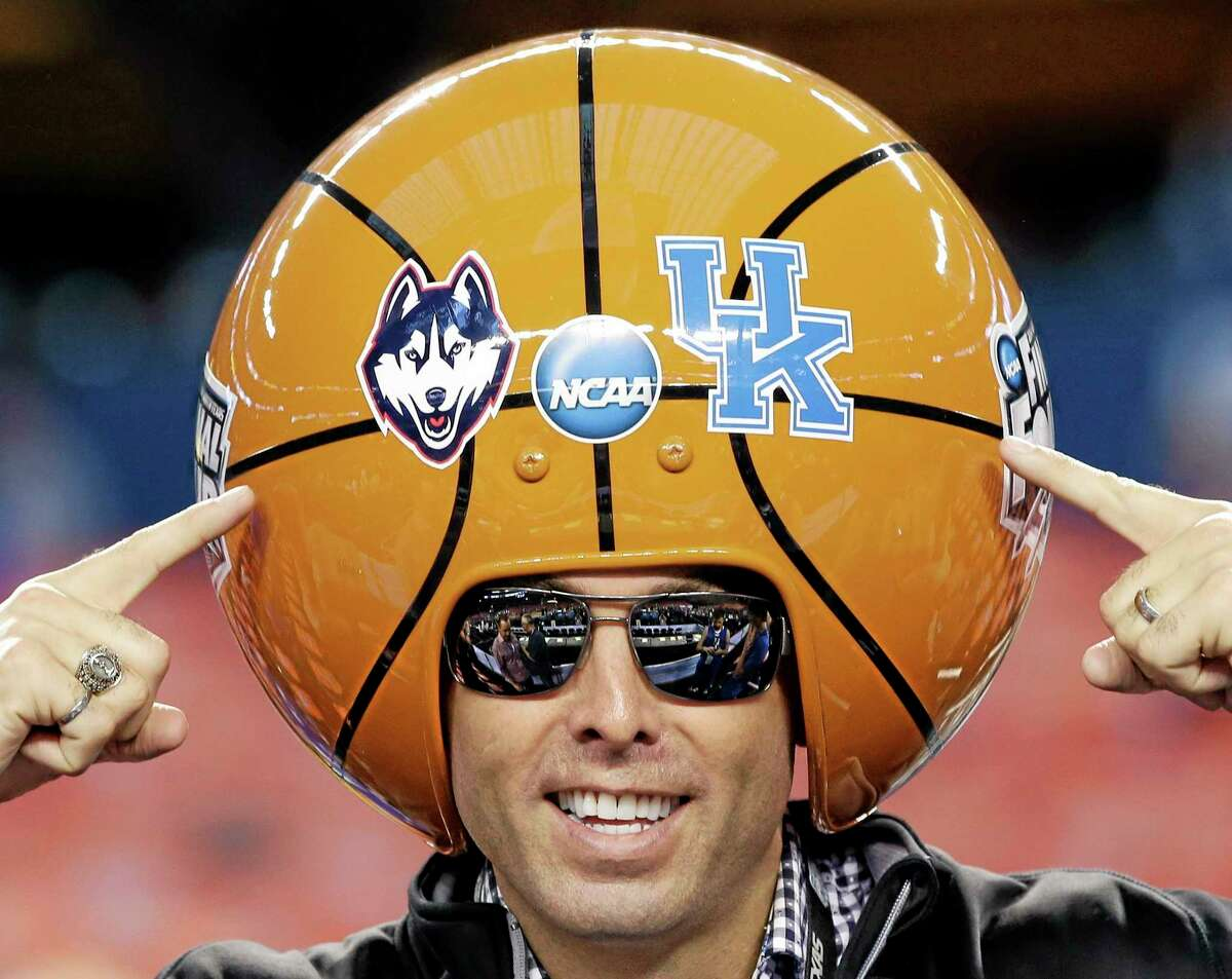 A basketball fan poses for a photo before the NCAA Final Four tournament college basketball championship game between Connecticut and Kentucky Monday, April 7, 2014, in Arlington, Texas. (AP Photo/David J. Phillip)