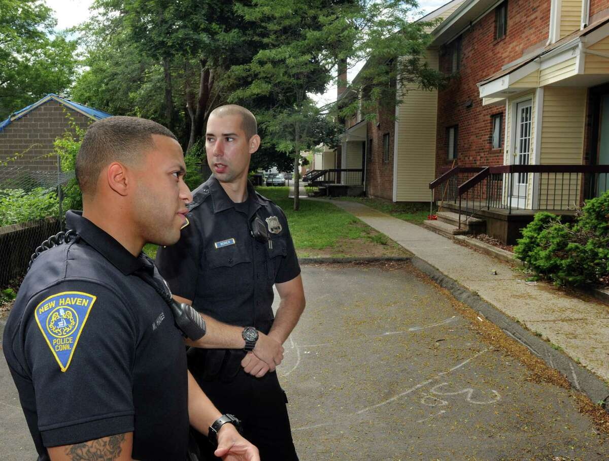 New Haven Police Officers, Michael Haines, left, and Brendan Borer, whose walking beat includes the Presidential Gardens Housing Complex, stop to talk to the Register. June 5, 2014. mlavitt@newhavenregister.com