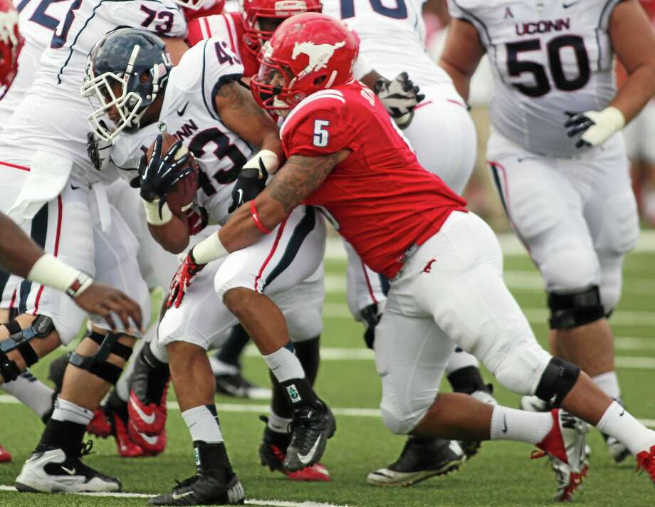 SMU's Randall Joyner (5) tackles UConn's Lyle McCombs (43) in the first half of a Nov. 16, 2013 game in Dallas. Photo: Ricky Moon — The Dallas Morning News   / The Dallas Morning News