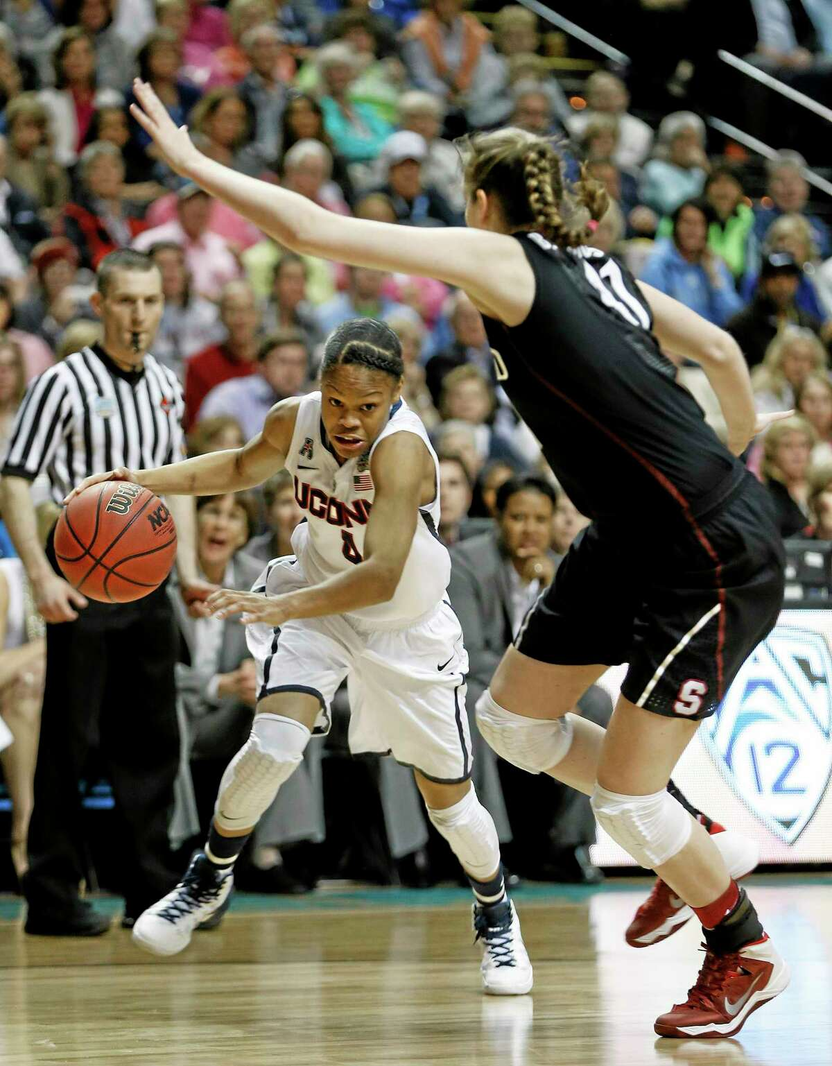Connecticut guard Moriah Jefferson (4) moves by Stanford forward Bonnie Samuelson (41) during the first half of the semifinal game in the Final Four of the NCAA women's college basketball tournament, Sunday, April 6, 2014, in Nashville, Tenn. (AP Photo/Mark Humphrey)