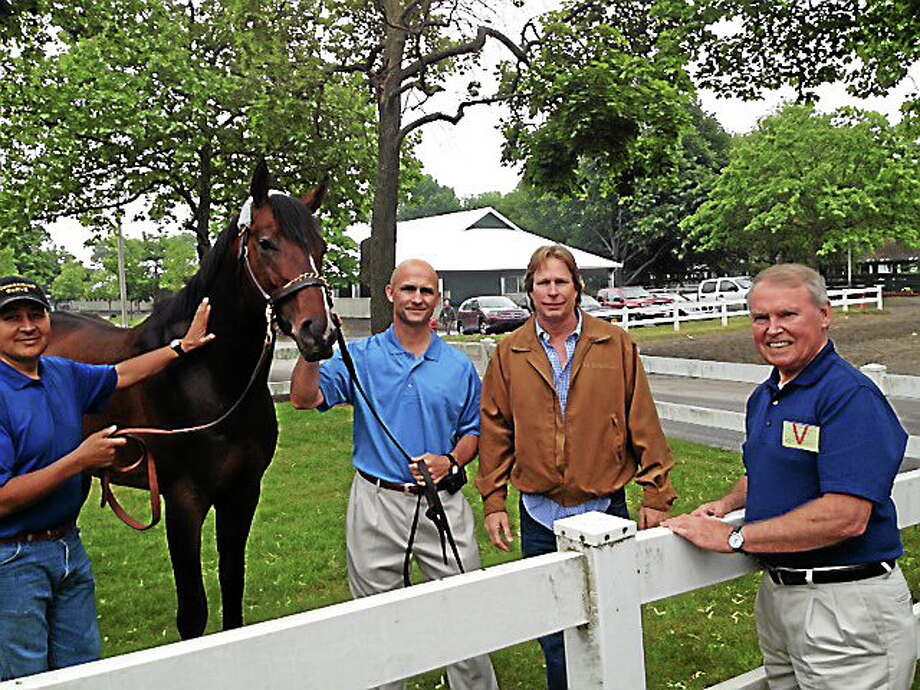Belmont Stakes participant Commanding Curve stands with his owner, Hamden's George Waldron, right, trainer Dallas Stewart, second from right, and West Point Thoroughbreds CEO Terry Finley. An unidentified groom is at left. Photo: Dan Nowak — Register