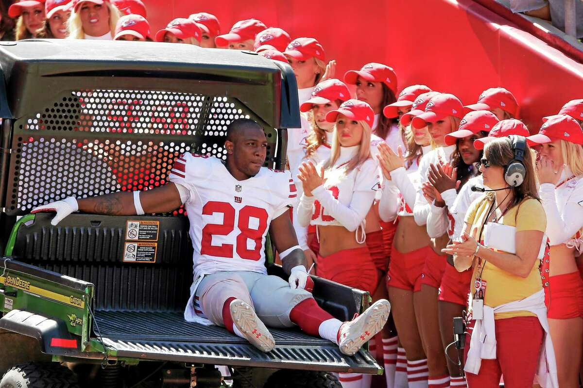 New York Giants cornerback Jayron Hosley is carted off the field after being injured during the first half of a Sept. 29, 2013 game against the Chiefs at Arrowhead Stadium in Kansas City, Missouri.