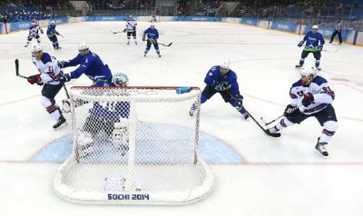 Phil Kessel of the United States puts in his third goal against Slovenia during the Men's Ice Hockey Preliminary Round Group A game on day nine of the Sochi 2014 Winter Olympics at Shayba Arena on Feb. 16.
