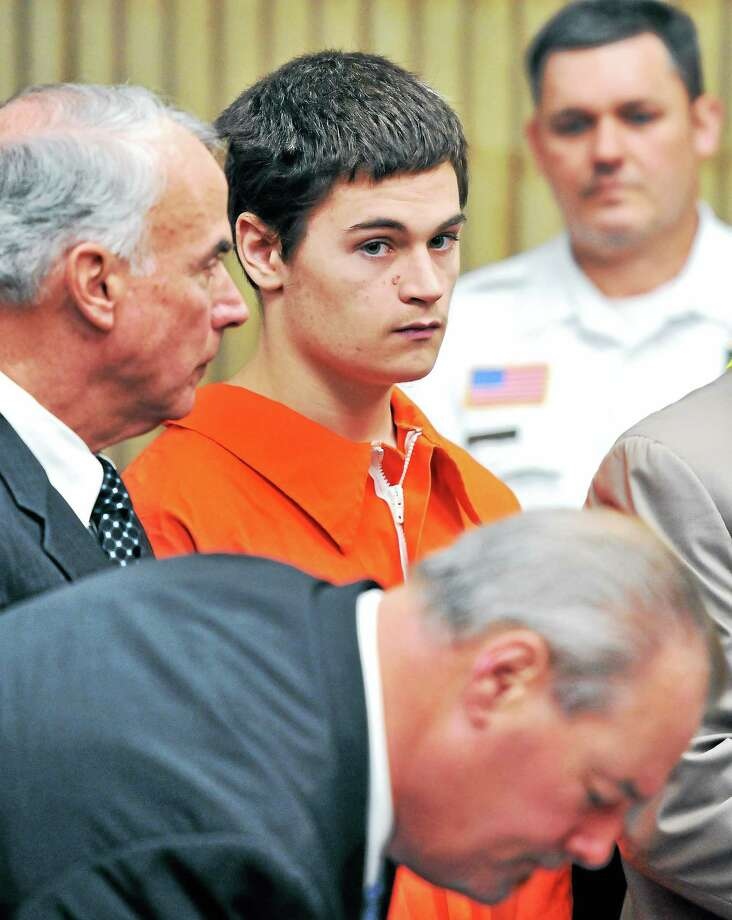 Christopher Plaskon, center, 17, appears Wednesday for a probable cause hearing at Superior Court in Milford in the stabbing death of Maren Sanchez. At left is his uncle and guardian Paul Healy; at bottom is attorney Edward Gavin. Photo: ARNOLD GOLD — NEW HAVEN REGISTER