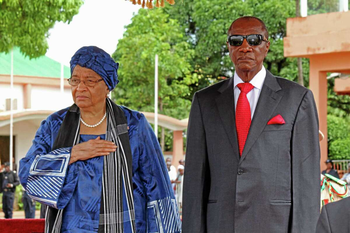 """Liberia President Ellen Johnson Sirleaf, left, and Guinean President Alpha Conde, right, after meetings on the Ebola virus in the city of Conakry, Guinea, Friday, Aug. 1, 2014. An Ebola outbreak that has killed more than 700 people in West Africa is moving faster than the efforts to control the disease, the head of the World Health Organization warned as presidents from the affected countries met Friday in Guinea's capital. Dr. Margaret Chan, director-general of the World Health Organization, said the meeting in Conakry """"must be a turning point"""" in the battle against Ebola, which is now sickening people in three African capitals for the first time in history. (AP Photo/ Youssouf Bah)"""