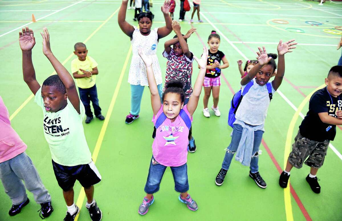 Children exercise with Beyond Fitness during the Back to School Rally at the Floyd Little Athletic Center in New Haven on August 2, 2014.