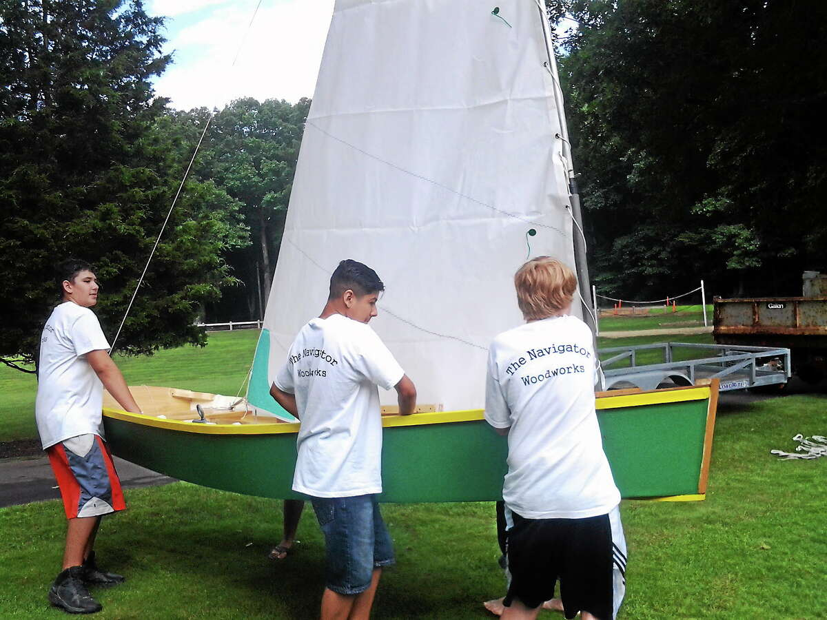 Hamden students learned math and science skills through boat-building.