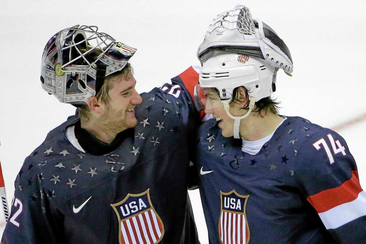 Team USA goaltender Jonathan Quick of Hamden greets forward T.J. Oshie, right, after Oshie scored the winning goal against Russia in the eighth round of a shootout after the two teams played to a 2-2 tie on Saturday at the Winter Olympics in Sochi, Russia.