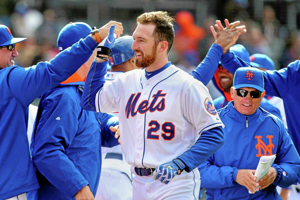 New York Mets first baseman Ike Davis (29) celebrates with his teammates after hitting a walk-off grand slam in the ninth inning Saturday.