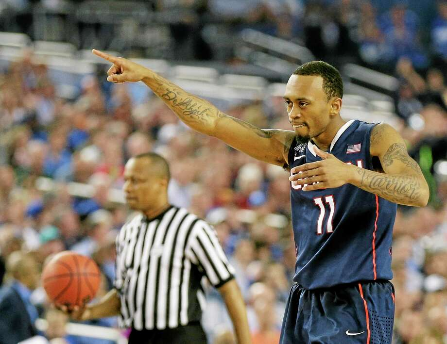 UConn guard Ryan Boatright celebrates as he walks down the court near the end of the seventh-seeded Huskies' 63-53 win over No. 1 Florida in the national semifinals at the Final Four on Saturday night in Arlington, Texas. Photo: Eric Gay — The Associated Press   / AP