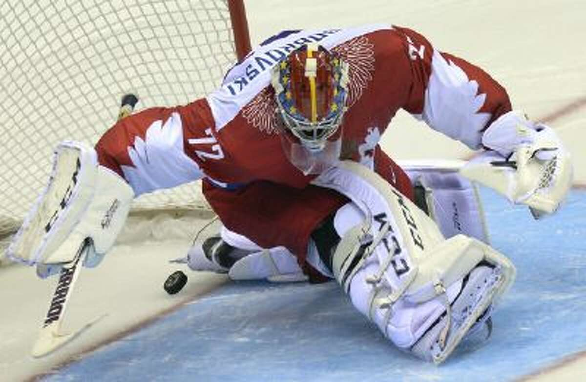 Russia's goalkeeper Sergei Bobrovski fails to stop the puck Feb. 15 during a penalty shootout session at the end of the Men's Ice Hockey Group A match USA vs Russia at the Bolshoy Ice Dome in Sochi, Russia.