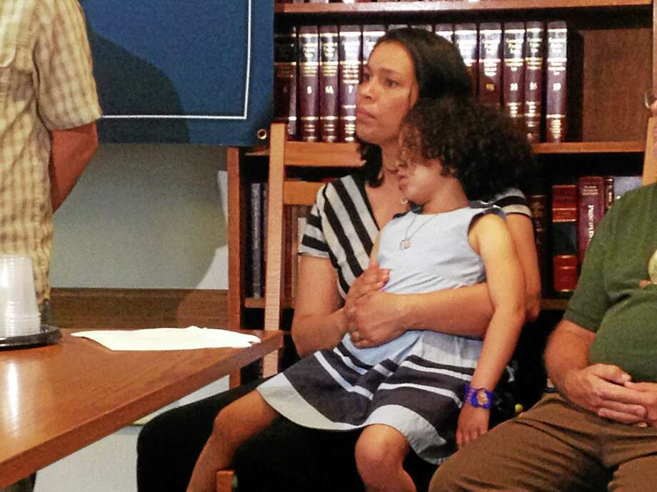 Sharon Giammarco holds her 5-year-old daughter, Blair, during the announcement of her husbands application submission. Photo: Journal Register Co.
