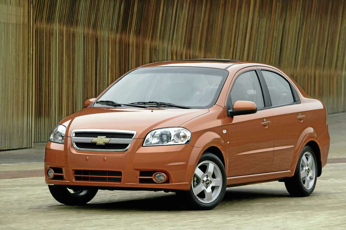 This undated file photo provided by General Motors shows the 2007 Chevrolet Aveo LT. General Motors on Wednesday, May 21, 2014 recalled 218,000 Chevrolet Aveo subcompact cars, model years 2004 through 2008. The daytime running light module in the dashboard center stack can overheat, melt and catch fire. (AP Photo/General Motors)