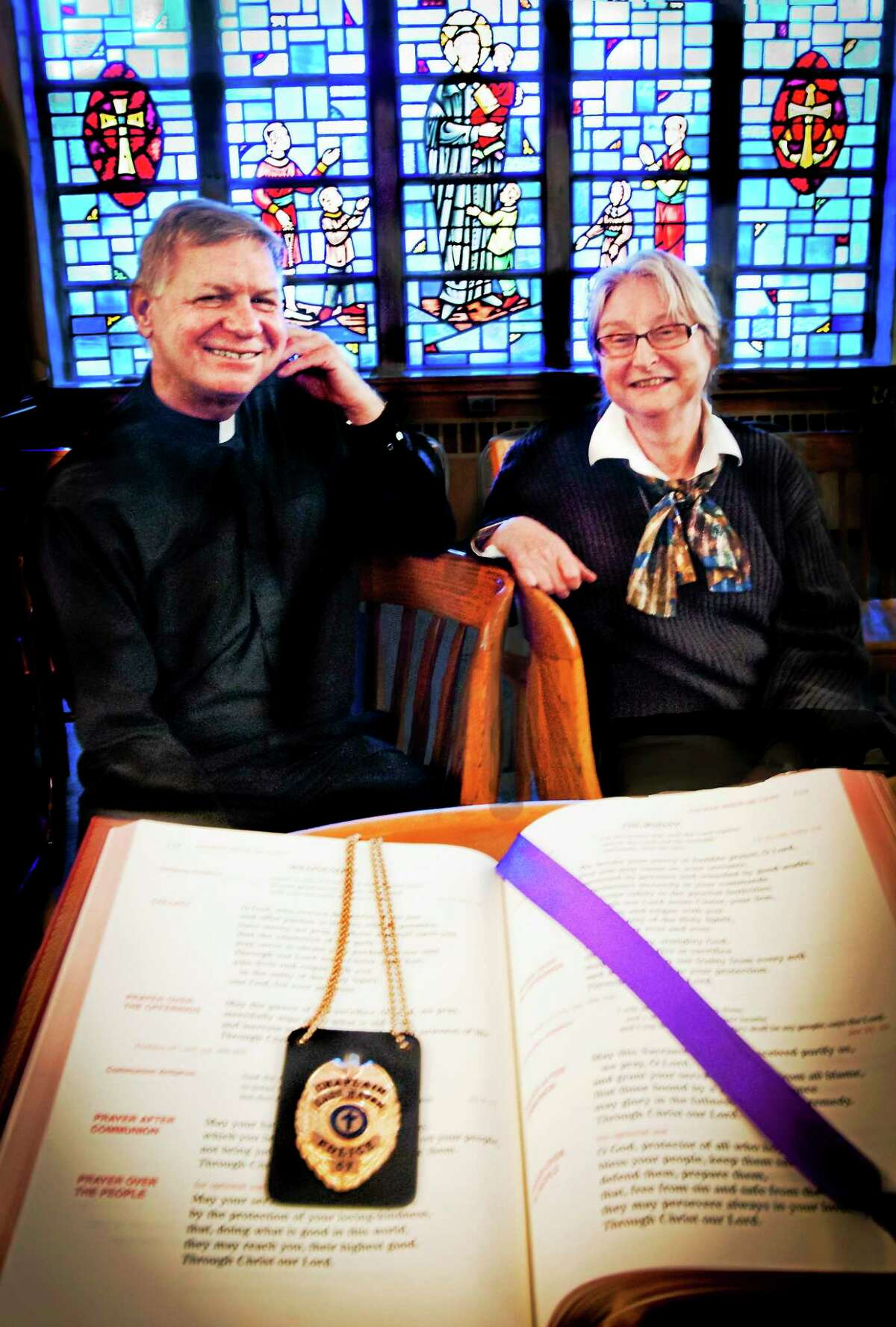 (Melanie Stengel - New Haven Register) Father Tom Sievel, of St. Vincent de Paul in East Haven, and Karen Gronback Johnson, ordained pastor in the United Church of Christ, and serving the Old Stone Church in East Haven, in the chapel of St. Vincent de Paul 4/3. They are Chaplains with the East Haven Police Department.