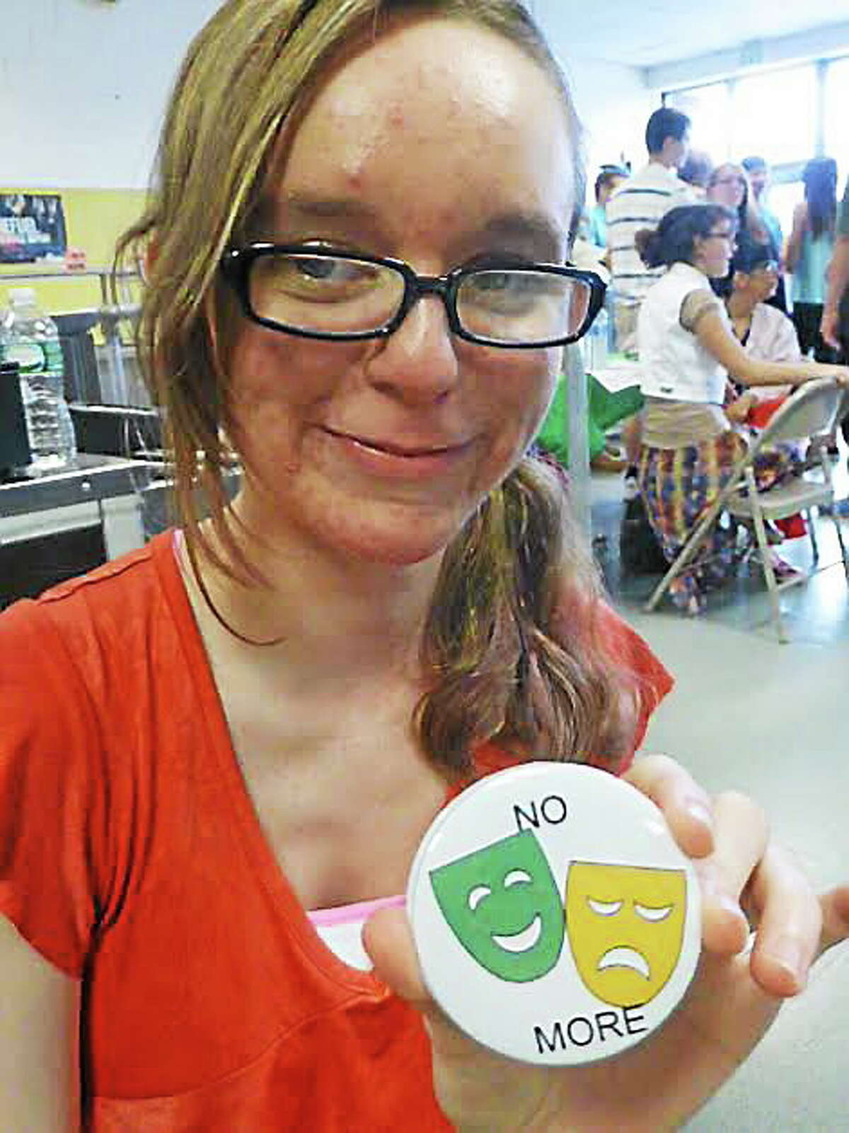 Emmett O'Brien Technical High School freshman Lily Desmond of Prospect shows off one of the buttons she created to raise funds for the school's leadership night.