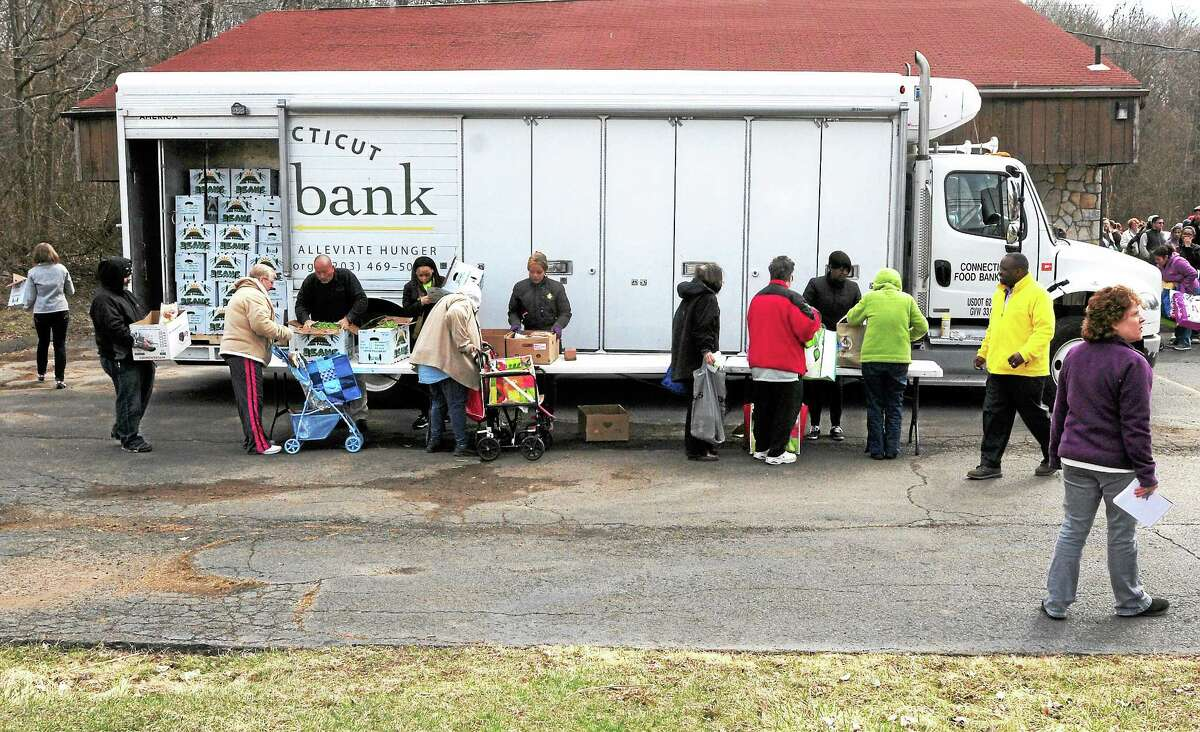 (Peter Hvizdak — New Haven Register) Connecticut Food Bank mobile pantry truck, Friday morning, April 4, 2014, at the New Life Apostolic Church in Branford.