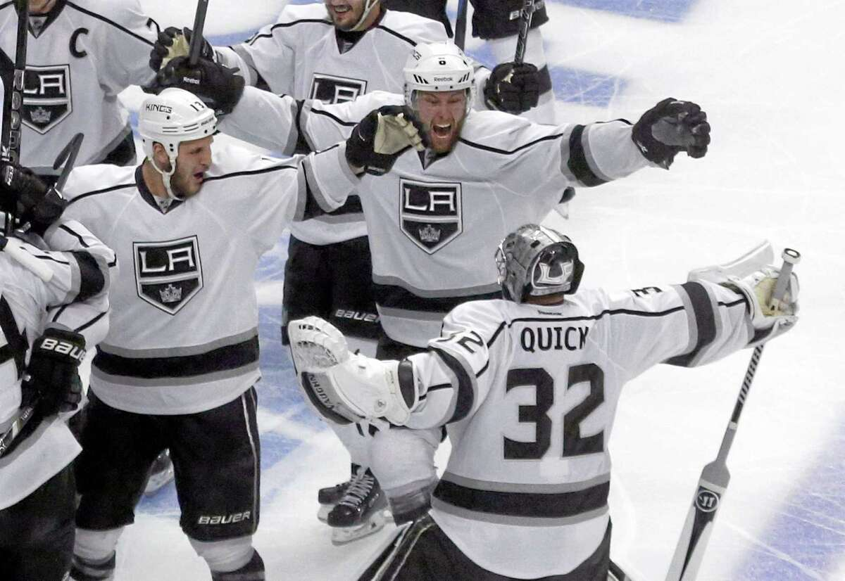 Los Angeles Kings goalie Jonathan Quick (32) celebrates with his teammates after the Kings defeated the Blackhawks 5-4 in overtime in Game 7 of the Western Conference finals Sunday. Up next is the Stanley Cup Finals and a showdown with the New York Rangers.