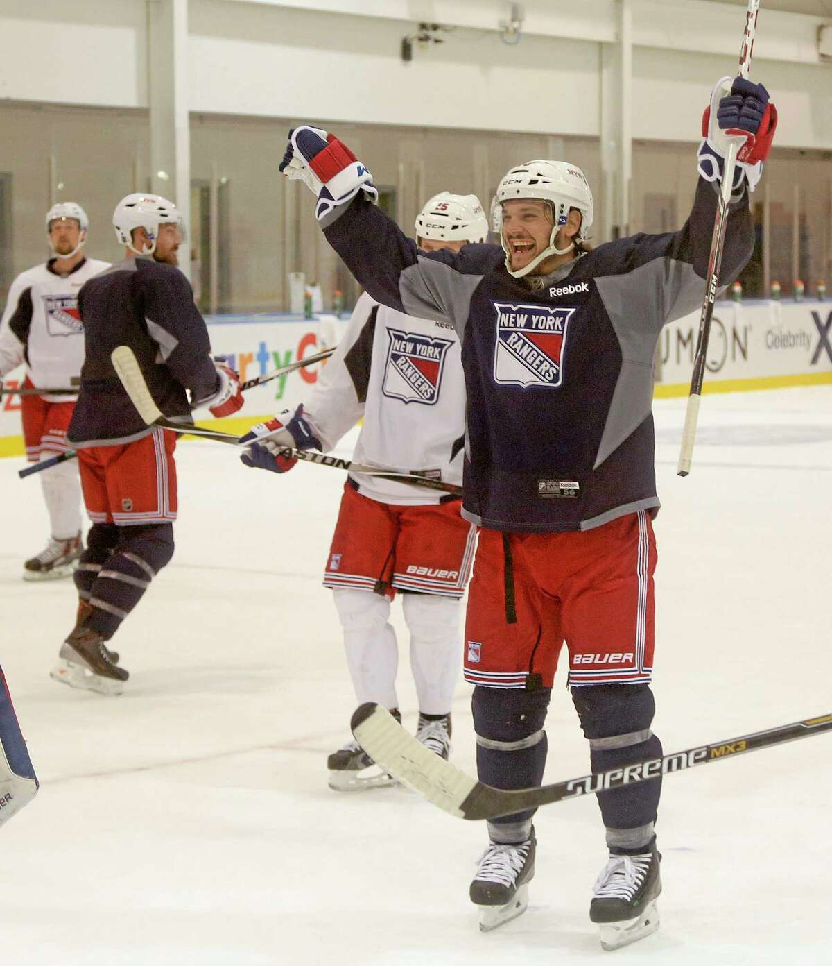 New York Rangers left wing Daniel Carcillo reacts after a goal scored during Monday's practice in Greenburgh, New York. The Rangers will face the Los Angeles Kings in Game 1 of Stanley Cup finals on Wednesday in Los Angeles.