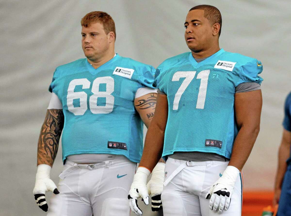 """An NFL-ordered investigation found Miami Dolphins tackle Jonathan Martin (71) was subjected to a """"pattern of harassment"""" by guard Richie Incognito (68) and two teammates."""