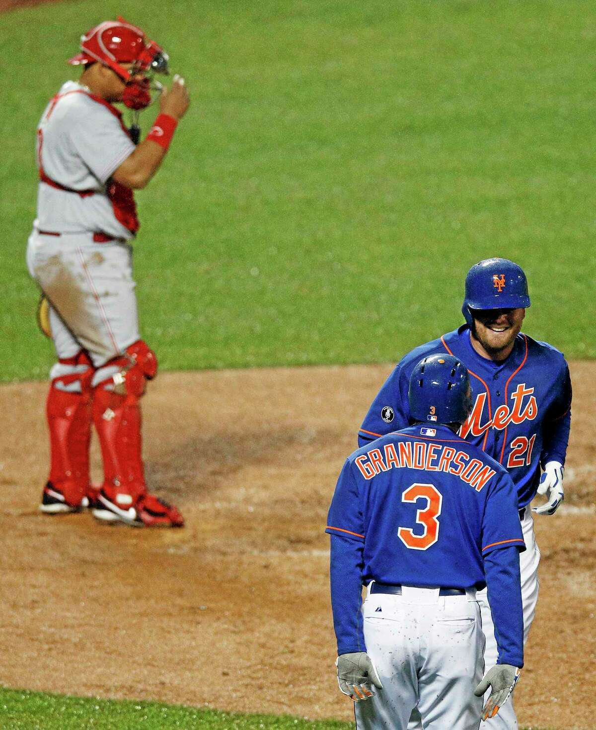 New York Mets first baseman Lucas Duda (21) is greeted by teammate Curtis Granderson (3) after hitting a two-run home run against the Cincinnati Reds.