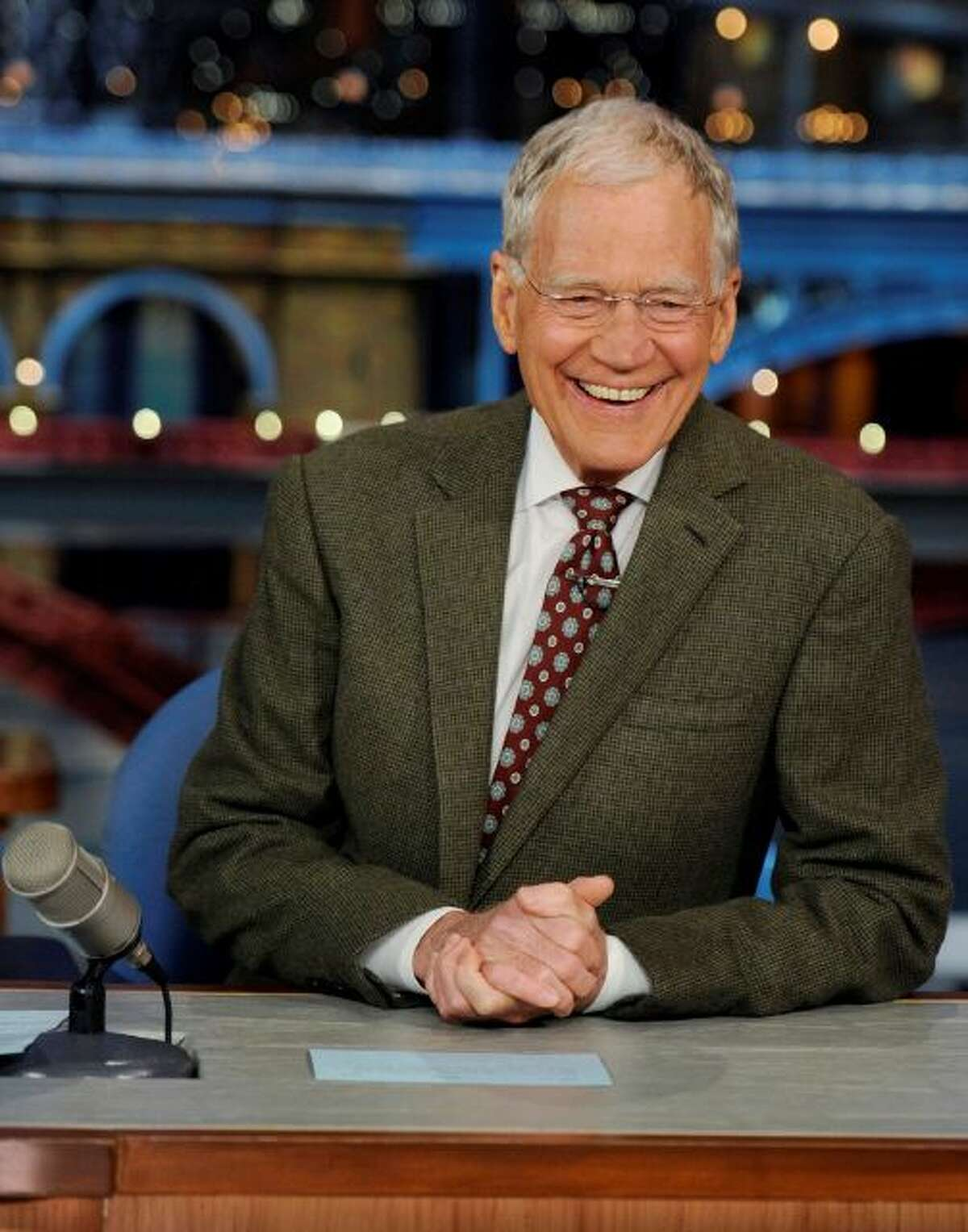 In this photo provided by CBS, David Letterman, host of the Late Show with David Letterman, smiles while seated at his desk in New York on Thursday, April 3, 2014. Letterman announced his retirement during Thursdays taping. Although no specific date was announced he told the audience that he will leave his desk sometime in 2015. (AP Photo/CBS, Jeffrey R. Staab) MANDATORY CREDIT, NO SALES, NO ARCHIVE, FOR NORTH AMERICAN USE ONLY