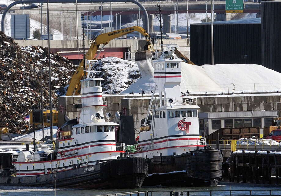 Much needed salt is taken off a barge that just arrived Friday at New Haven Terminal that will be distributed around the state. Many towns are nearly out of salt. Photo: Peter Casolino — New Haven Register