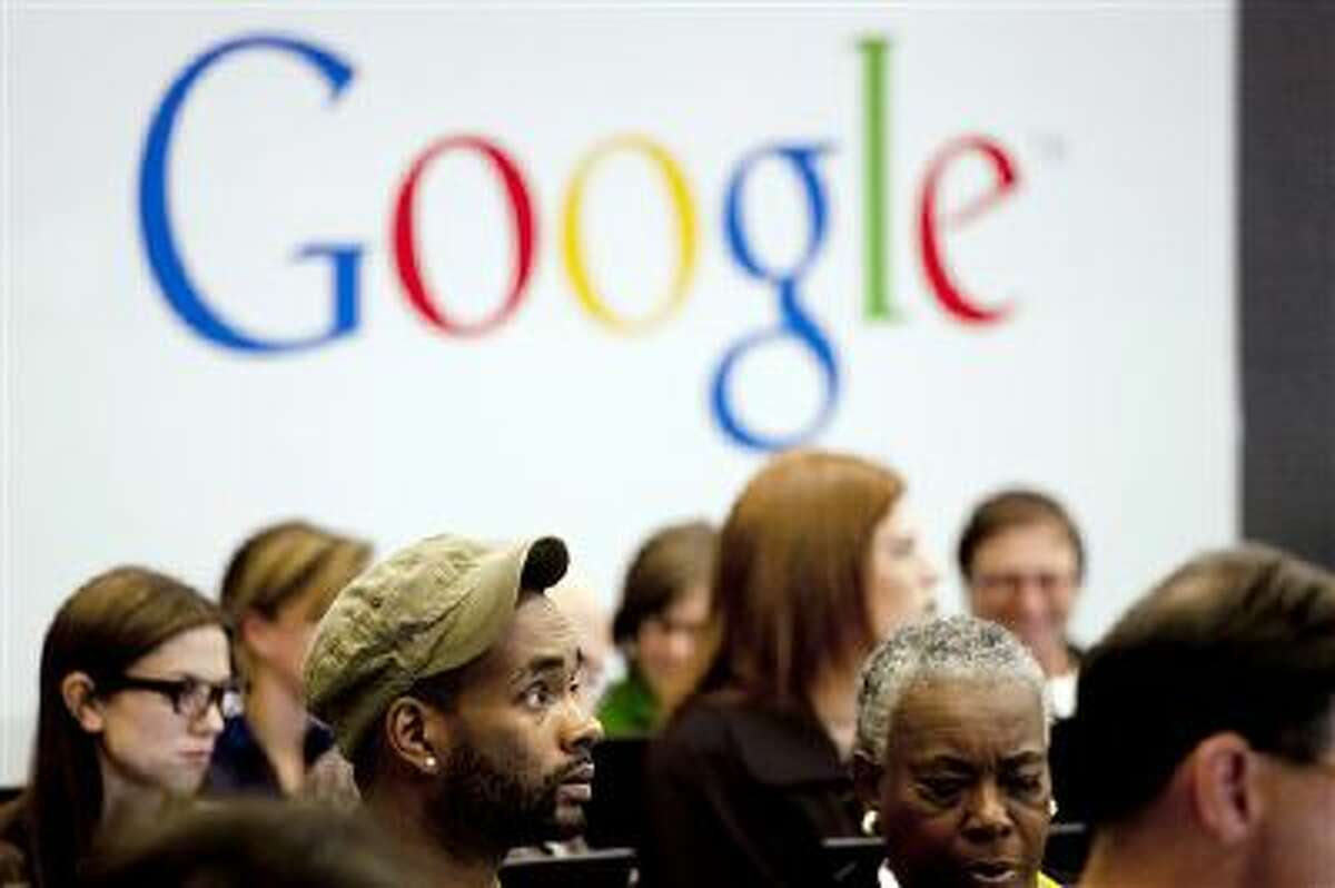 People are shown attending a workshop at Google offices in New York.