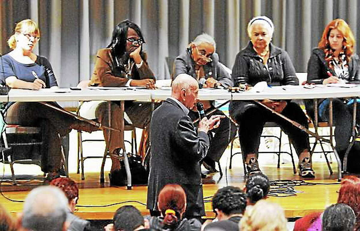 Don Dimenstein, retired director of the Department of Education in New Haven, explains the need for Hispanic outreach in New Haven during a public hearing in front of the aldermanic Finance Committee at Career High School Thursday. Peter Casolino ó New Haven Register