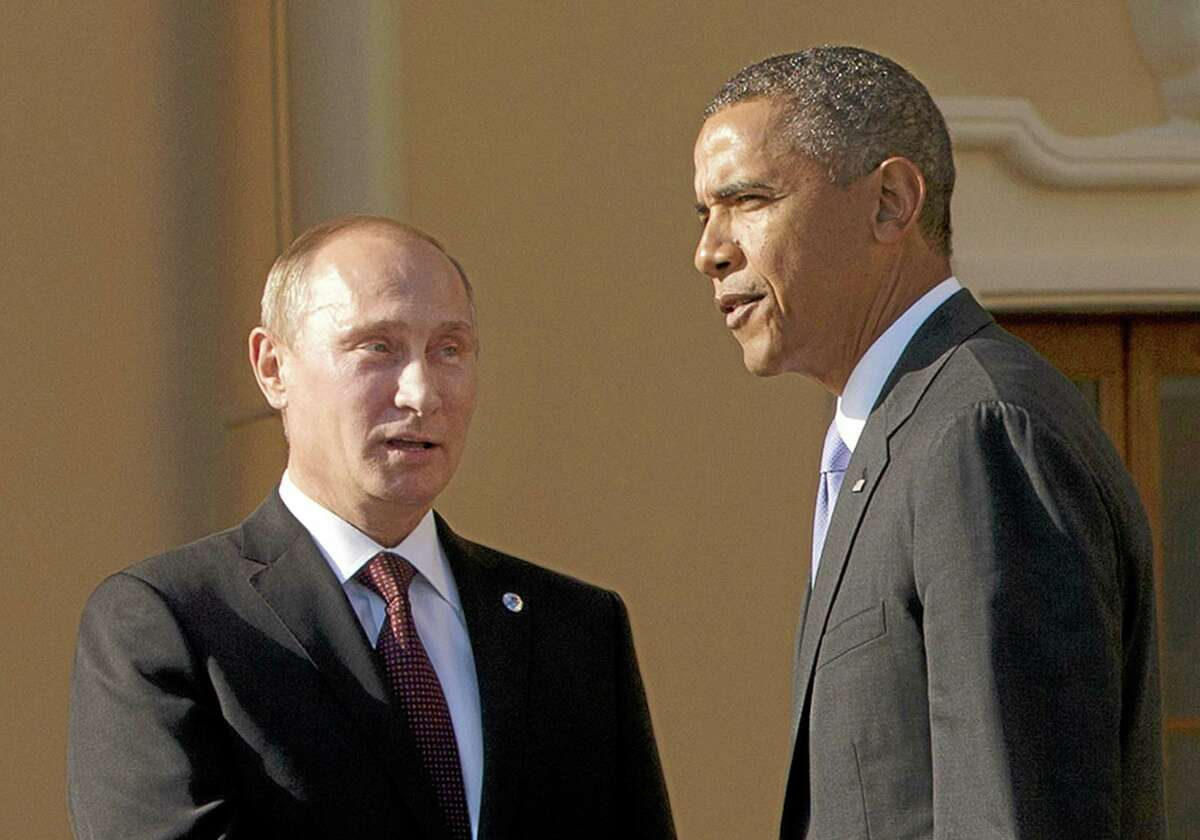 In this Sept. 5, 2013 file photo, President Barack Obama shakes hands with Russian President Vladimir Putin during arrivals for the G-20 summit at the Konstantin Palace in St. Petersburg, Russia. Congress is stepping up pressure on the White House to confront Russia over allegations that it is cheating on a key nuclear arms treaty, a faceoff that could further strain U.S.-Moscow relations and dampen President Barack Obama's hopes to add deeper cuts in nuclear arsenals to his legacy.