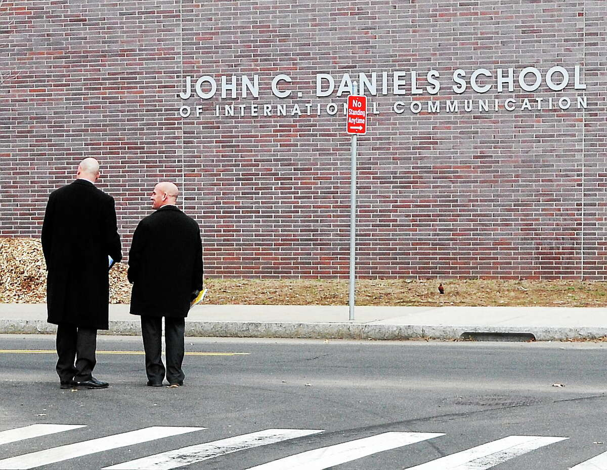 (Peter Hvizdak - New Haven Register) New Haven Police detectives on Congress Avenue and Daggett street near John C. Daniels School Friday morning April 4, 2014 investigating the murder of a 16-year-old victim that was found in front of 78 Daggett Street last night