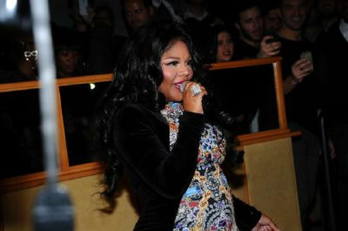 Lil Kim performs at The Blonds After Party - Fall 2014 Mercedes - Benz Fashion Week at Gilded Lily on February 12, 2014 in New York City.