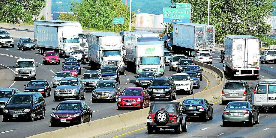 In a file photo, traffic builds near Exit 46 on I-95. Photo: Peter Casolino — New Haven Register