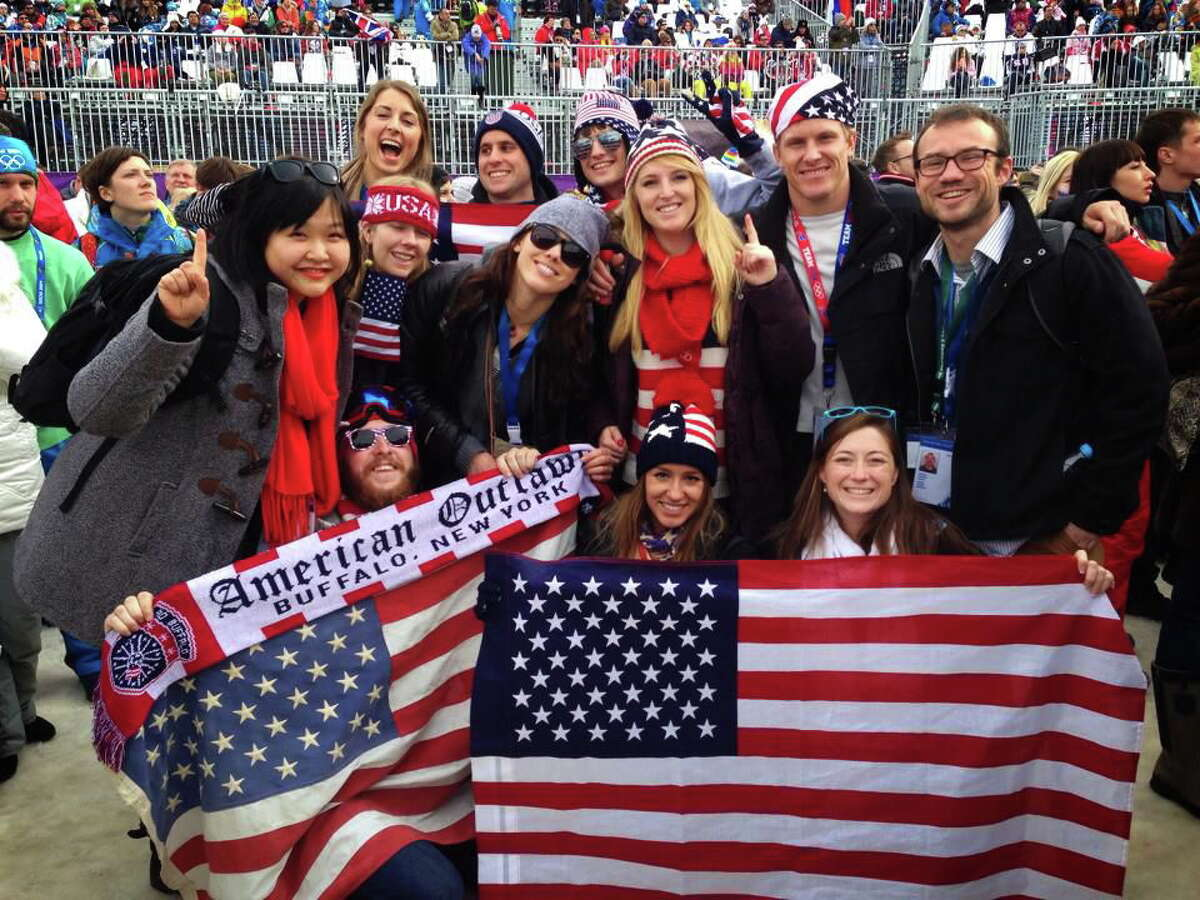 Yale's Team Climate members, along with several Team USA fans, cheer on athletes at the women's snowboard slopestyle competition in Sochi, Russia.